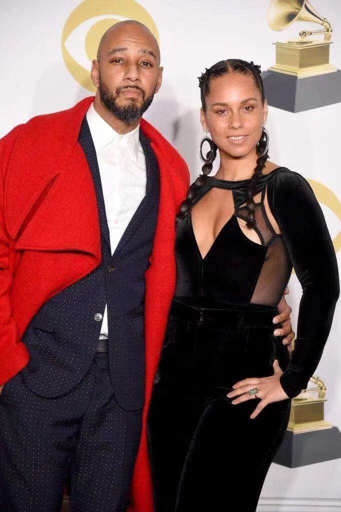 音乐人Swizz Beatz(左)与艾丽西亚·凯斯(Alicia Keys)。图片:Photo by Michael Loccisano/Getty Images for NARAS