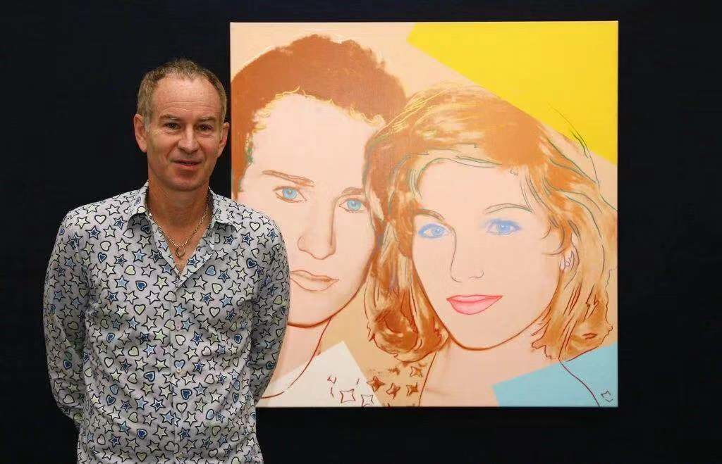 约翰·麦肯罗(John McEnroe)与安迪·沃霍尔的《Portrait of John McEnroe and Tatum O'Neal》(1986)。图片:Photo by Gareth Cattermole/Getty Images